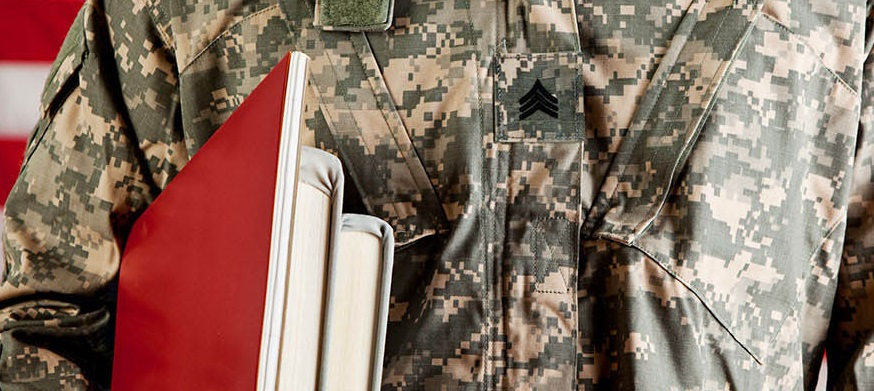 A veteran holding books